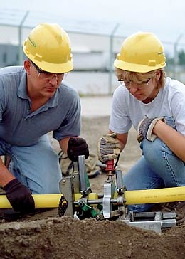 man and woman installing gas fuel line